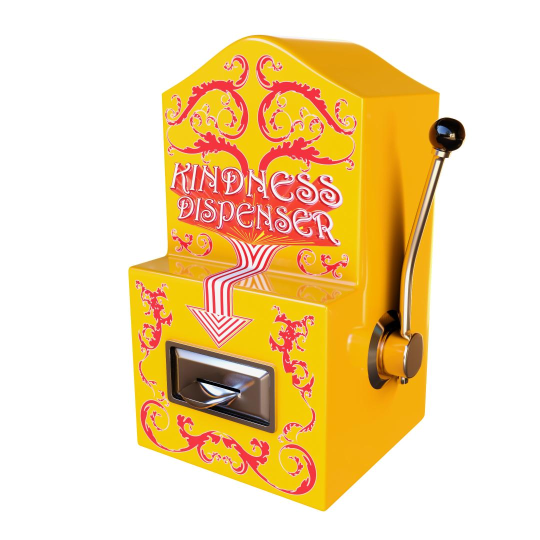 A yellow arcade machine with a pull down handle attached to the side. There is a red decorative pattern on the front and a stripy arrow that points at a silver dispenser. The machine has the words 'Kindness Dispenser' on it.