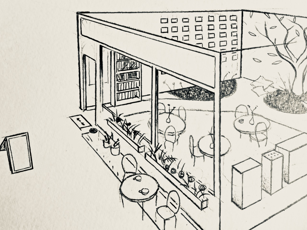 Black pen drawing on white paper showing the design of a shop front. There is cafe seating, flowers in window beds, a bookcase and a tree inside the shop.